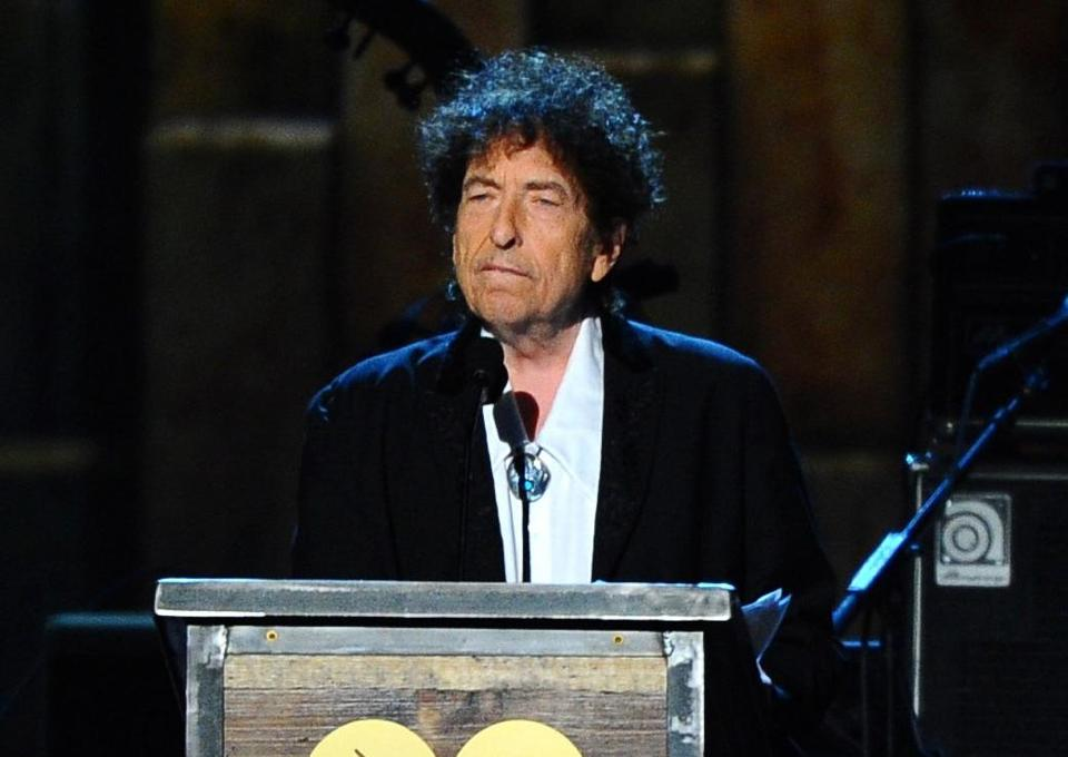 In this  file photo, Bob Dylan accepts the 2015 MusiCares Person of the Year award at the 2015 MusiCares Person of the Year show in Los Angeles. (Photo by Vince Bucci/Invision/AP, File)