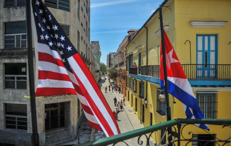 "(FILES) This file photo taken on March 17, 2016 shows Cuban and US flags in Havana. President Donald Trump's administration will press Cuba on human rights progress, a top US official said May 9, 2017. The White House is carrying out a ""comprehensive policy review,"" said Francisco Palmieri, a senior regional official in the State Department.""I suspect that there will be important differences that will emerge between how this administration plans to address the situation in Cuba"" and the policies of former president Barack Obama, he said. / AFP PHOTO / YAMIL LAGEYAMIL LAGE/AFP/Getty Images"