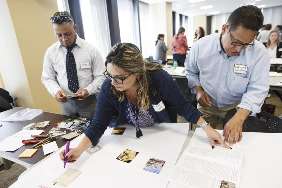 Boston, MA - 6/15/2017 - Students Gonzalo Basualdo, Andrea Clarke, and Nestor Grullon work on class material during a seminar held by the US Citizenship and Immigration Service to help adult educators and representatives from immigrant-serving organizations who help immigrants prepare them for the citizenship and naturalization process in Boston, MA, June 15, 2017. (Keith Bedford/Globe Staff)