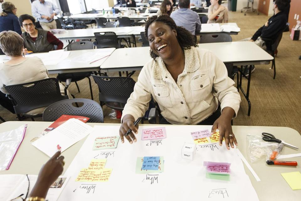 Boston, MA - 6/15/2017 - Student Sheryl Buchanan laughs as she goes through class material during a seminar held by the US Citizenship and Immigration Service to help adult educators and representatives from immigrant-serving organizations who help immigrants prepare them for the citizenship and naturalization process in Boston, MA, June 15, 2017. (Keith Bedford/Globe Staff)