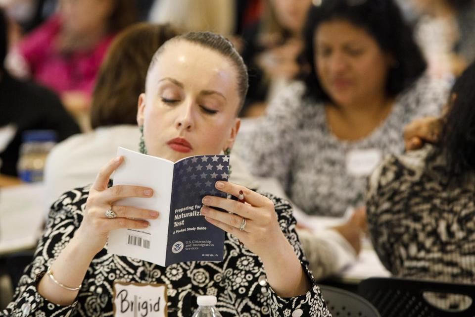Boston, MA- 6/15/2017 - A student looks over class material during a seminar held by the US Citizenship and Immigration Service to help adult educators and representatives from immigrant-serving organizations who help immigrants prepare them for the citizenship and naturalization process in Boston, MA, June 15, 2017. (Keith Bedford/Globe Staff)