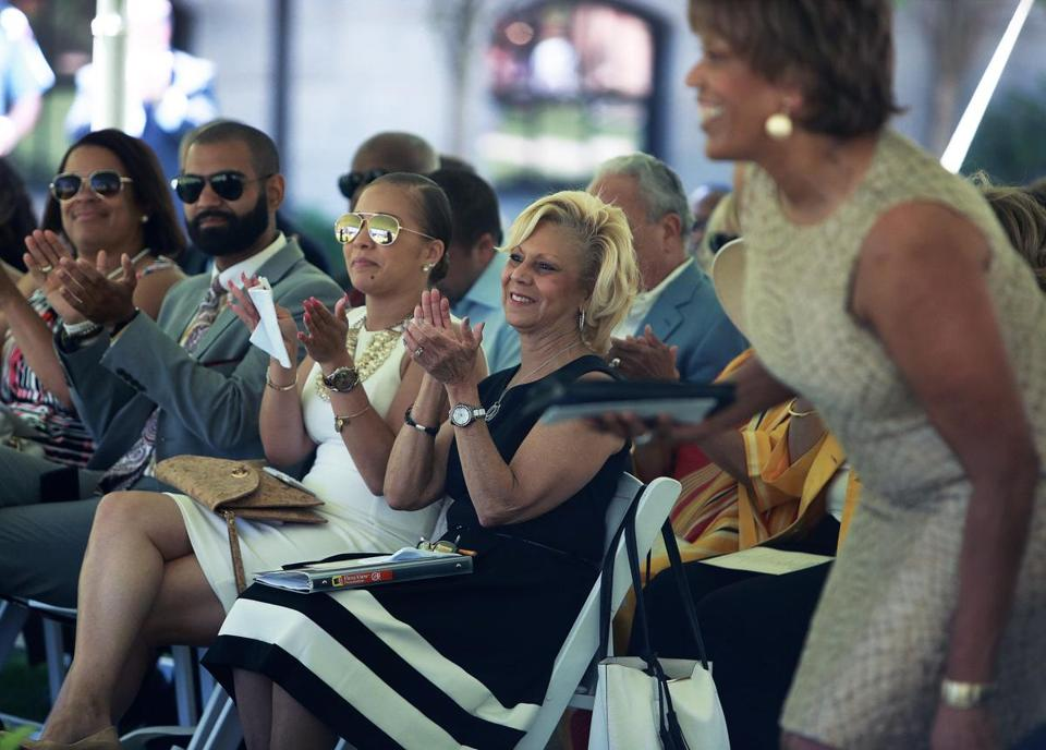 "Boston, MA: June 15, 2017: Barbara E. Edelin (center, in black dress) ,the widow of Dr. Kenneth C. Edelin, is pictured as she applauds as the Rev. Liz Walker (right) is introduced and gets up to go to the podium to deliver her remarks during the dedication ceremony for the naming of the ""Dr. Kenneth C. Edelin Square"" near the Boston Medical Center. (Globe Staff Photo/ Jim Davis)"