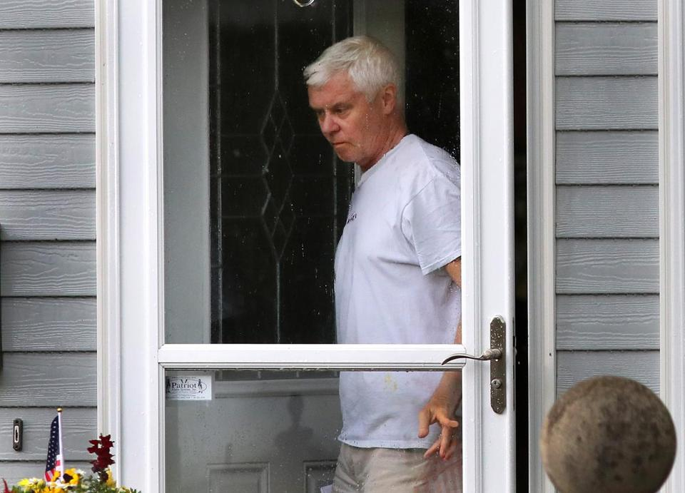 Former youth hockey coach Robert Richardson got his mail at his home in Dorchester in June.