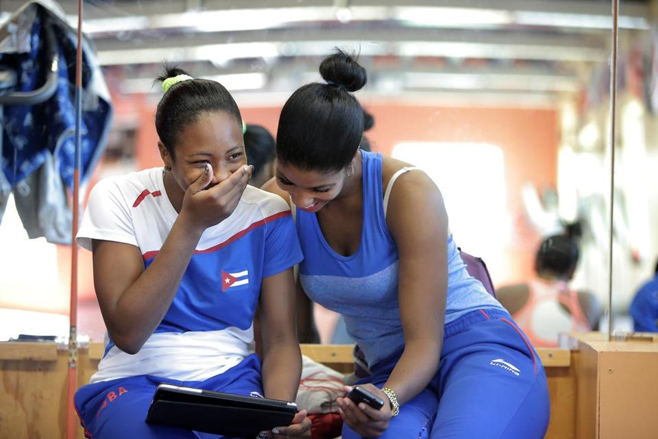 Leidis Veranes Mustelier (left) and Yanet Batista Arizon shared a laugh after their workout.