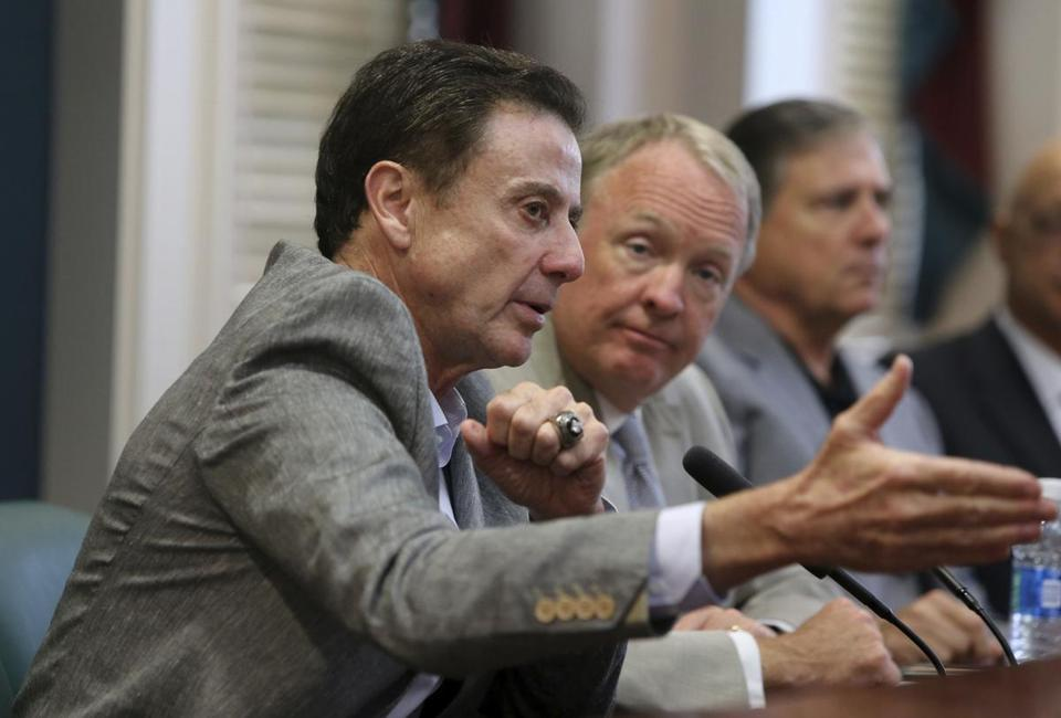 University of Louisville basketball coach Rick Pitino speaks during an NCAA college basketball news conference Thursday, June 15, 2017, in Louisville, Ky. The NCAA suspended Pitino on Thursday for five ACC games following sex scandal investigation. A former men's basketball staffer is alleged to have hired strippers to entertain players and recruits. (Pat McDonogh/The Courier-Journal via AP)