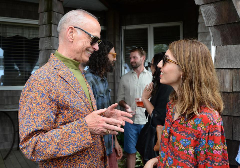 John Waters talks to Sofia Coppola at the Provincetown International Film Festival party Saturday at Land's End Inn.