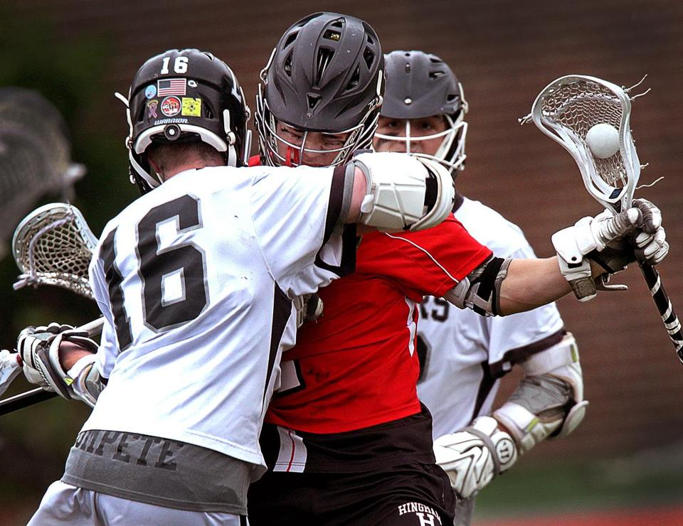 Hingham's Thomas Welch, (2) absorbs a hit from Longmeadow's John Barron, (16), but the Harbormen dealt the crushing blow with their 16-7 victory in the Div. 2 state title game.