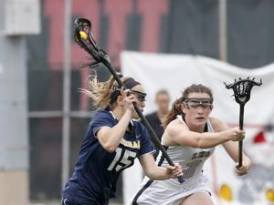 Boston, MA: 6/17/17 Needham's Maeve Barker (15) shoots against the defenive effort of Longmeadow's Kay Conway (3) during the first half of the Division 1 MIAA lacrosse state championship game. Photo/Mary Schwalm for The Boston Globe (18hslacrosse)