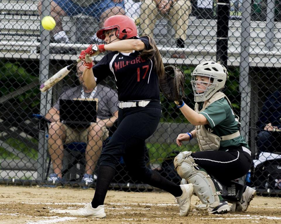 8.3.2827582534_Sports_18hssoftball Milford third baseman Katitlyn DeCapua (17) makes contact as Wachusett Regional catcher Lizzie Miles (12) waits during the Div. 1 State Softball Final in Worcester State College in Worcester, Mass., Saturday, June 17, 2017. (Robert E. Klein for the Boston Globe)