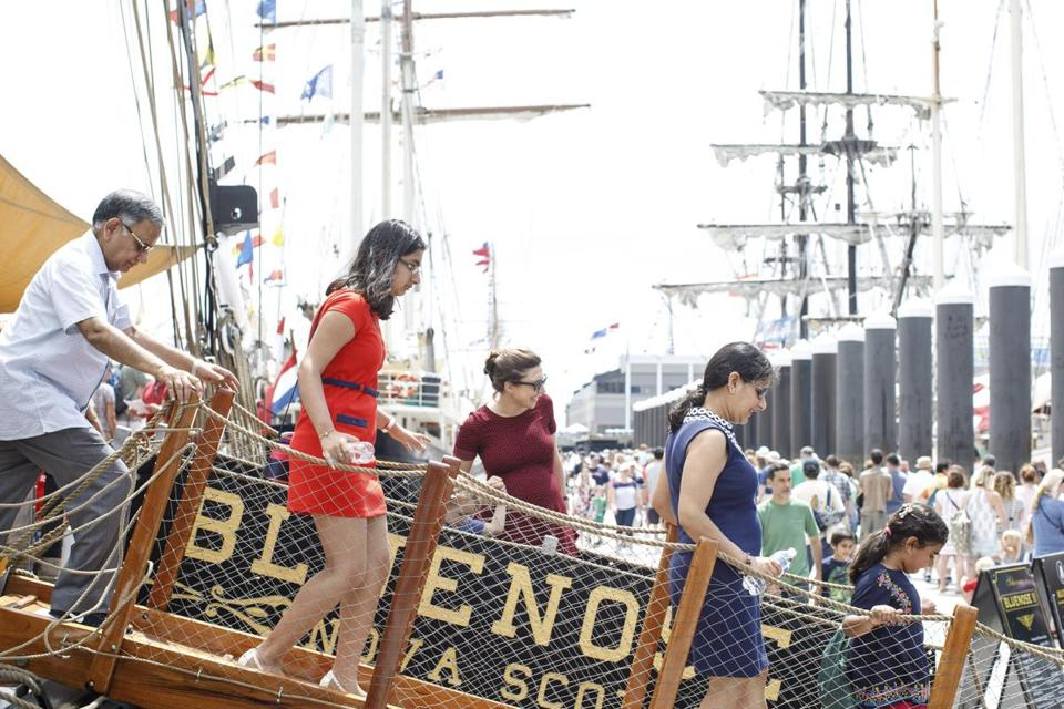 Boston, MA - 6/18/2017 - Visitors walk down the gang plank of the tall ship Bluenose II from Nova Scotia, Canada during public tours of ships that are taking part of the Sail Boston event on Fan Pier in Boston, MA, June 18, 2017. (Keith Bedford/Globe Staff)
