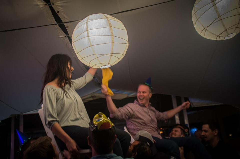 A newly engaged couple is hoisted on chairs during a Horah dance.