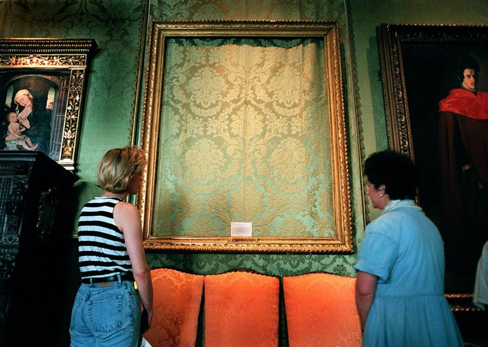 Boston-6/12/96- Rembrandt's, 'The Storm on the Sea of Galilee', is just a framed section of fabric wall covering as theses two visitors to the Gardner Museum observed. This was one of the paintings stolen in a mysterious heist that is yet unsolved. Library Tag 12201999 Metro