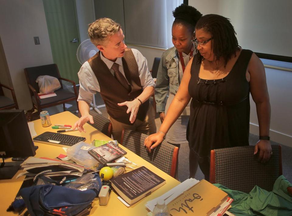 Jesse Edsell-Vetter (left) explains a role playing exercise to Leneva Penton (right) of Urban Edge and Chanelia Dorest of the Metropolitan Boston Housing Partnership.