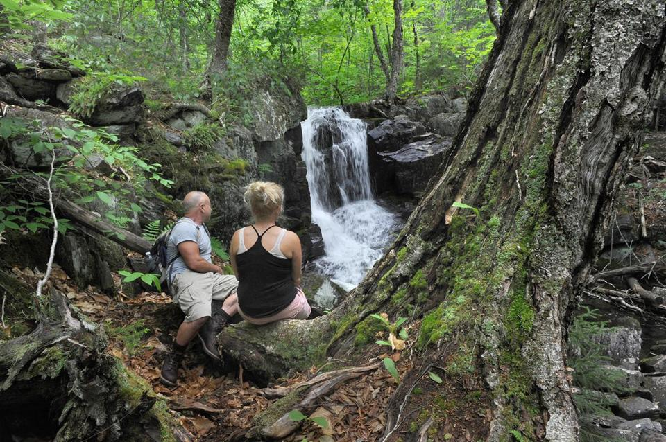 Bruce Linehan and his fiancée, Jenn Hogg, paused at Goodell Brook Falls in Monson, near the Appalachian Trail.