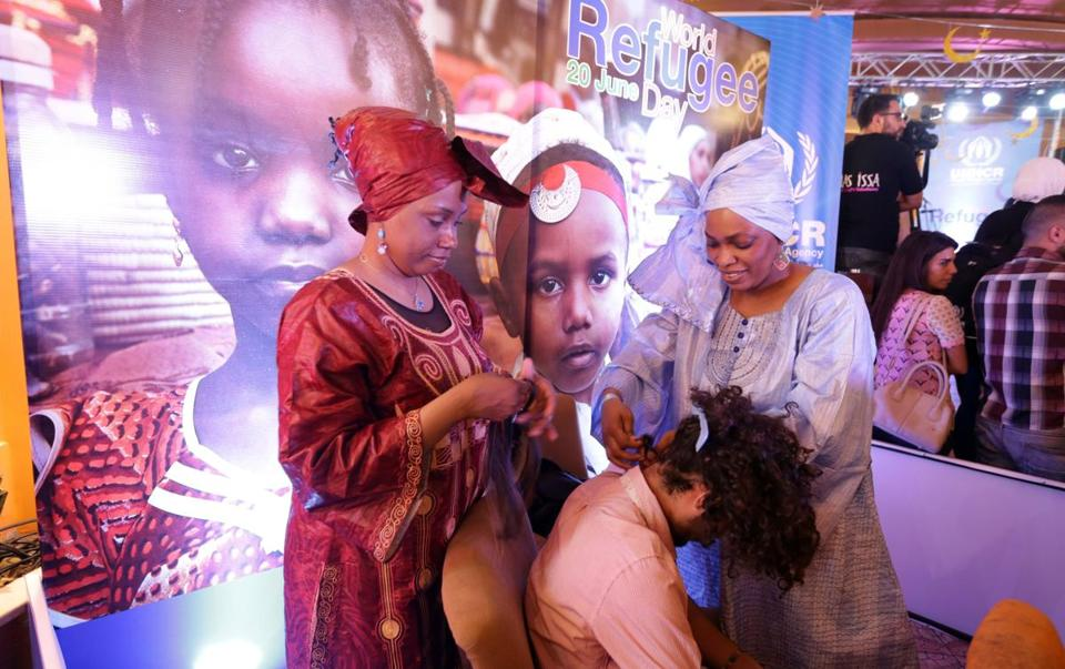 Somali refugees braided hair at a World Refugee Day event in Damascus, Syria this week. Massachussetts lawmakers are working to reduce barriers in the state to hair braiders, who are mostly African-American women and women of African and Caribbean descent.