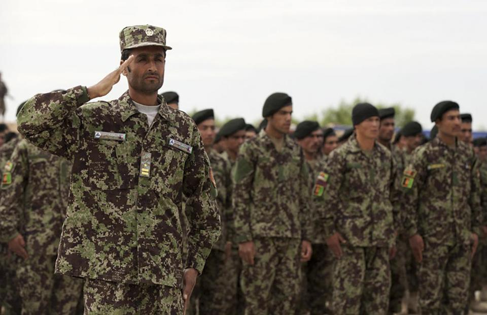 In an undated handout photo, Afghan National Army soldiers wearing new uniforms with a proprietary camouflage pattern that replicates lush forests, first ordered in 2017. The Pentagon paid for the proprietary camouflage that was inappropriate for the environment based on a single Afghan official's tastes, a government watchdog said. (U.S. Marine Corps/Cpl. Alejandro Pena via The new York Times) -- EDITORIAL USE ONLY --