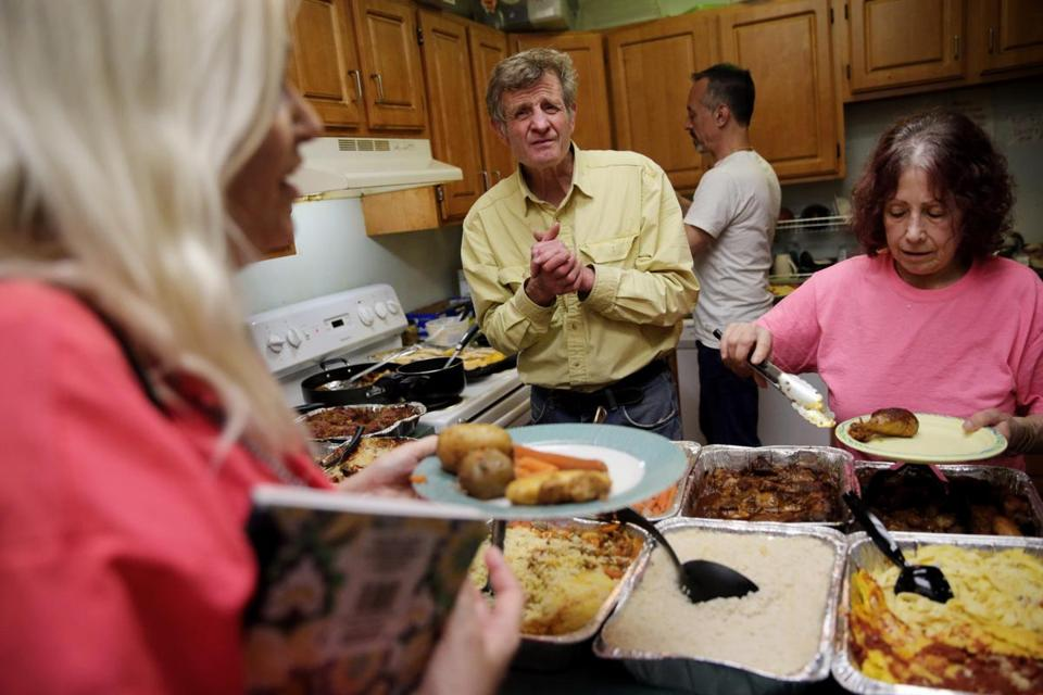 Bill Gidrewicz (center) and director Nanci Baren served a lunch to members of the Ruby Rogers Center in Somerville.