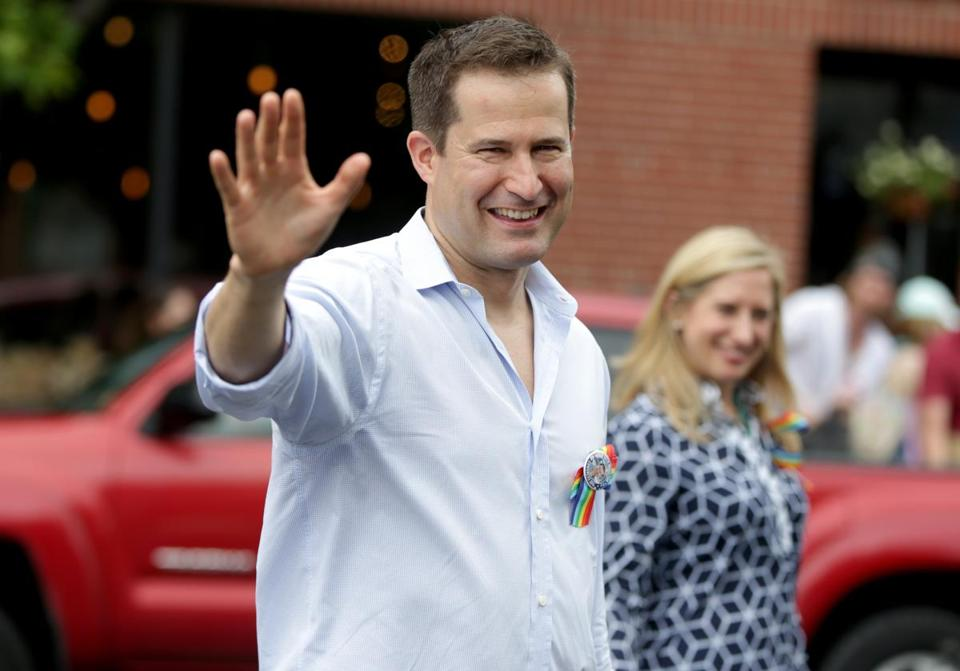 Representative Seth Moulton and fiancee Liz Boardman marched in the Salem Gay Pride Parade in June.