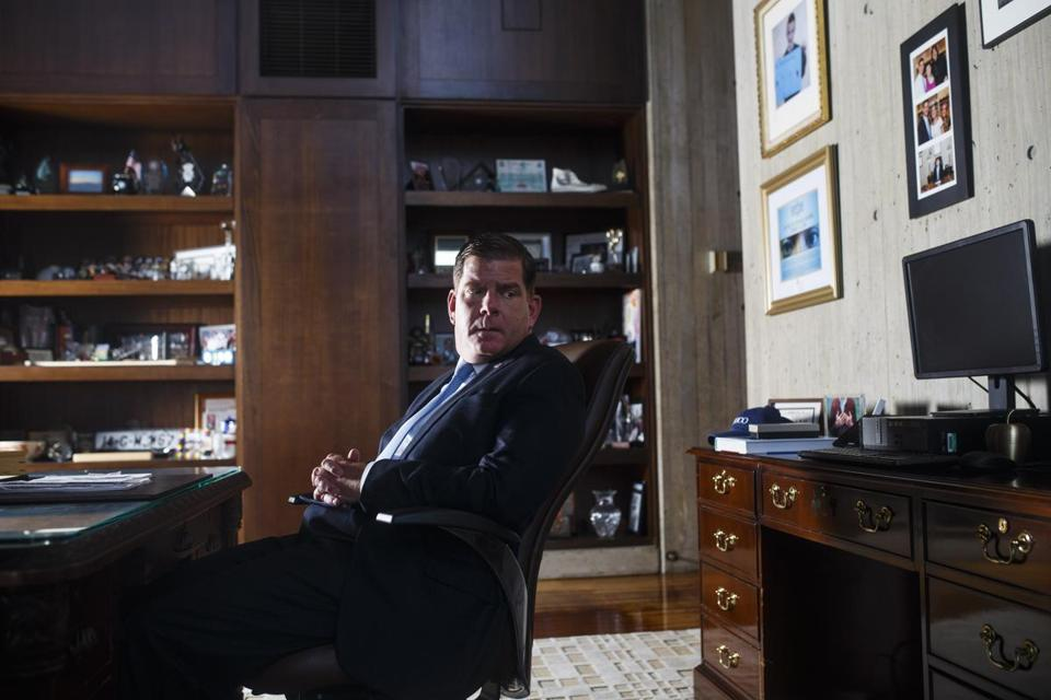 Mayor Martin J. Walsh sat at his desk in his office in City Hall in Boston.