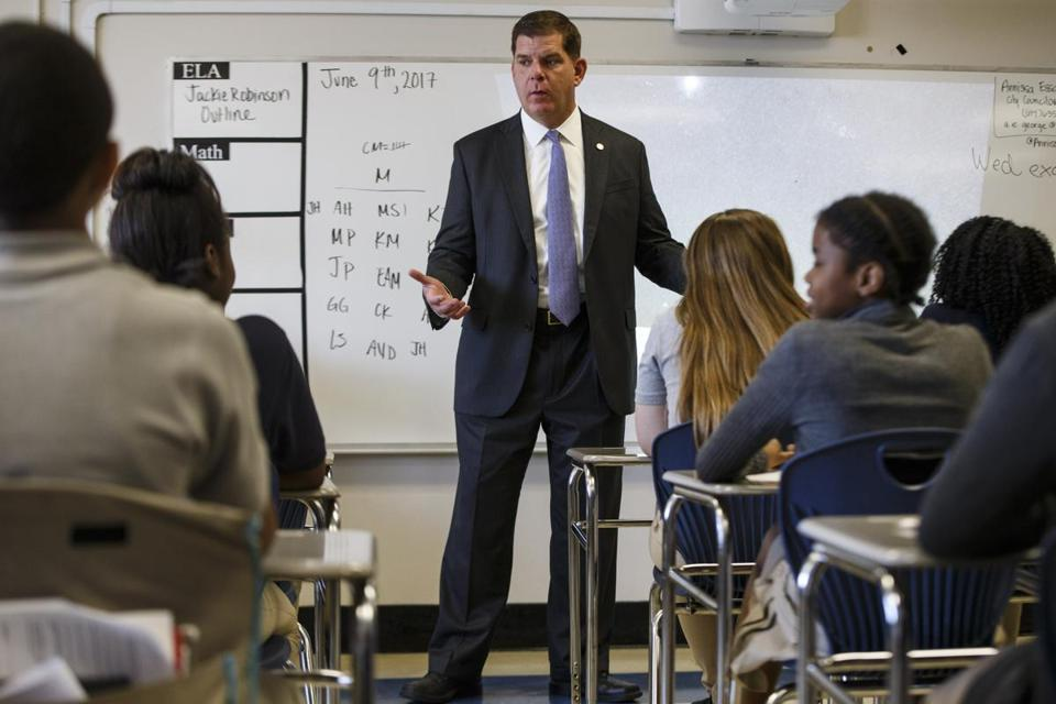 Boston Mayor Marty Walsh talks to middle schoolers during a tour of their school in June 2017.