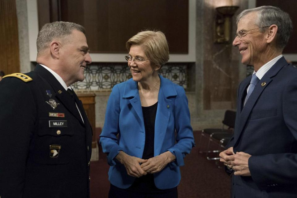 Senate Armed Services Committee member Sen. Elizabeth Warren, D-Mass., center, talks with acting Army Secretary Robert Speer, right, and Army Chief of Staff Gen. Mark Milley on Capitol Hill in Washington, Thursday, May 25, 2017, prior to the start of the committee's hearing on the Army's fiscal 2018 budget. (AP Photo/Andrew Harnik)