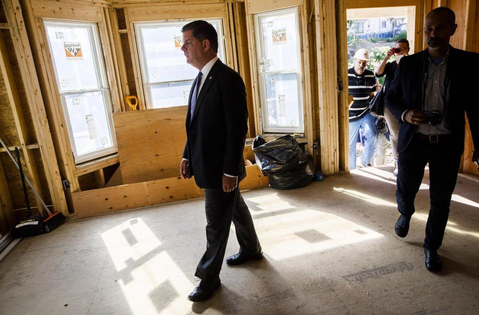Mayor Martin J. Walsh toured a house being renovated as affordable housing earlier this month. Business interests have helped give Walsh a well-funded campaign account.