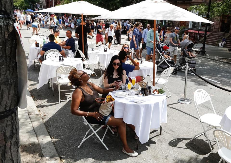 Diners ate at a street cafe last summer on a section of Newbury Street closed to vehicle traffic.