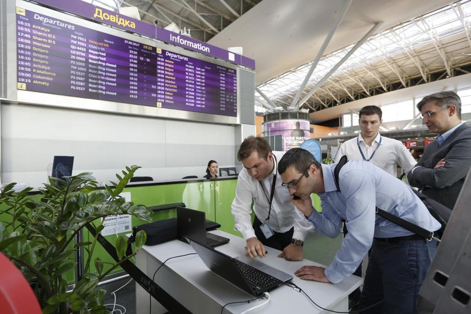 Airport employees used a laptop computer at Boryspil airport in Kiev Tuesday after malicious data-scrambling software threatened check-in terminals.