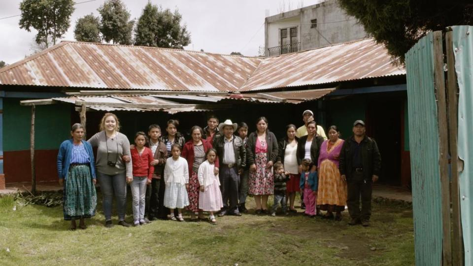 23nolynnraw - Marylys Merida poses with her family in her film, Manos Abierta en esta Tierra (Open hands in this land). Everywhere she went she found devout people with a resolve to help others no matter the circumstances. (Manos Abierta en esta Tierra)