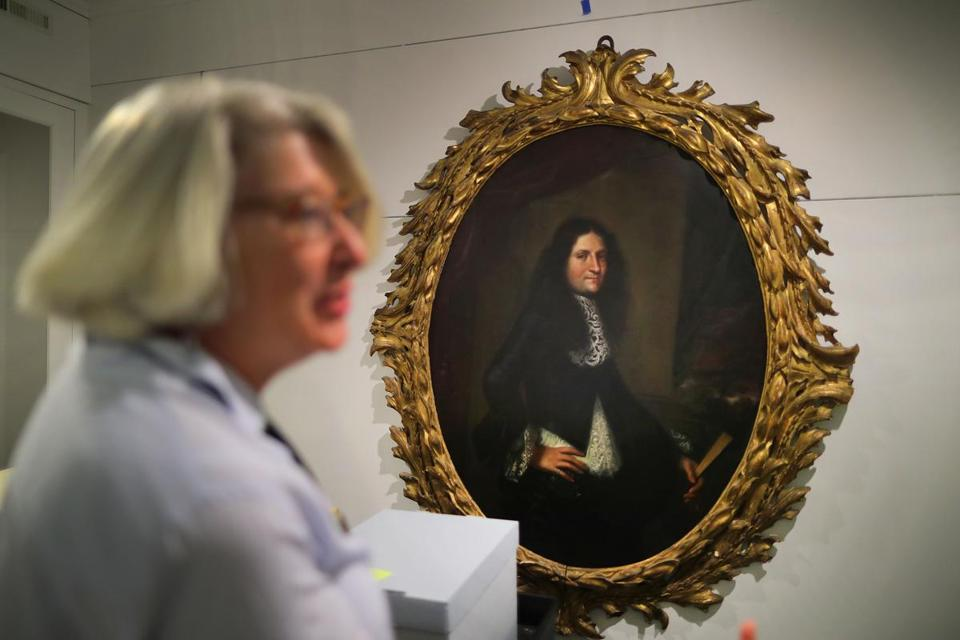 Alison Bassett, manager of archives at the research center, stood near a painting from the Lyman Preserve.