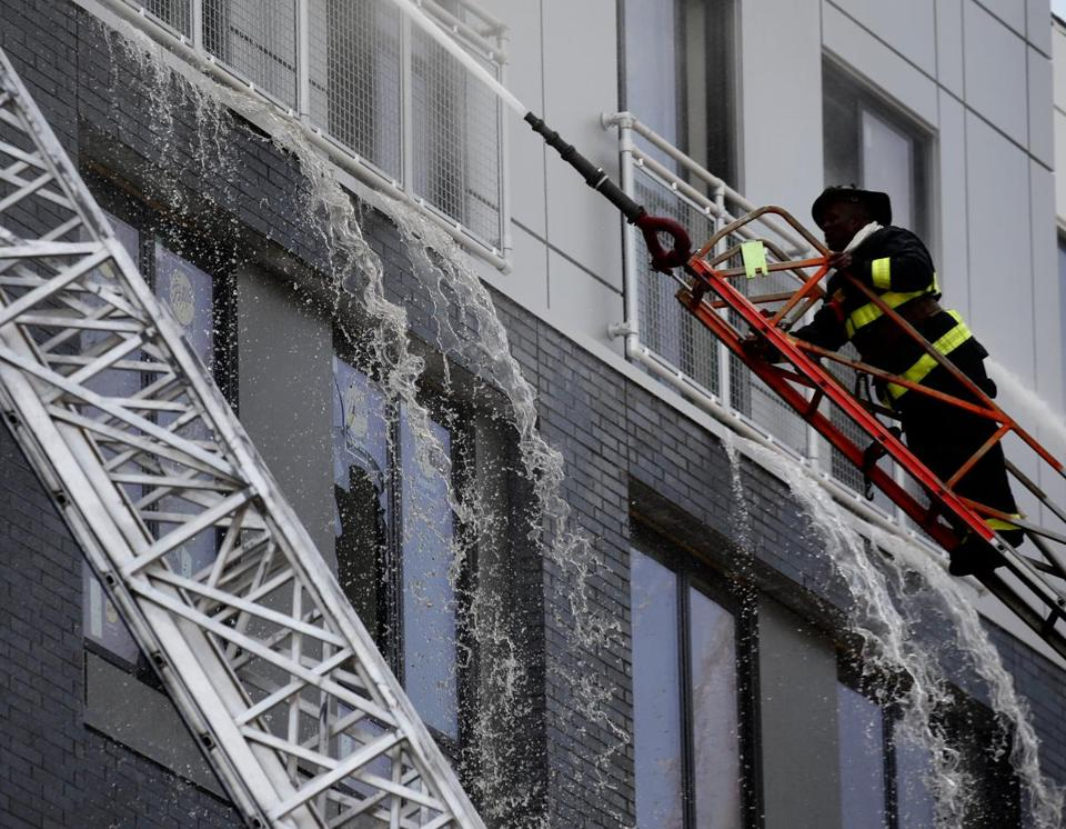 Firefiighters battled a six-alarm fire in a building under construction in Dorchester.