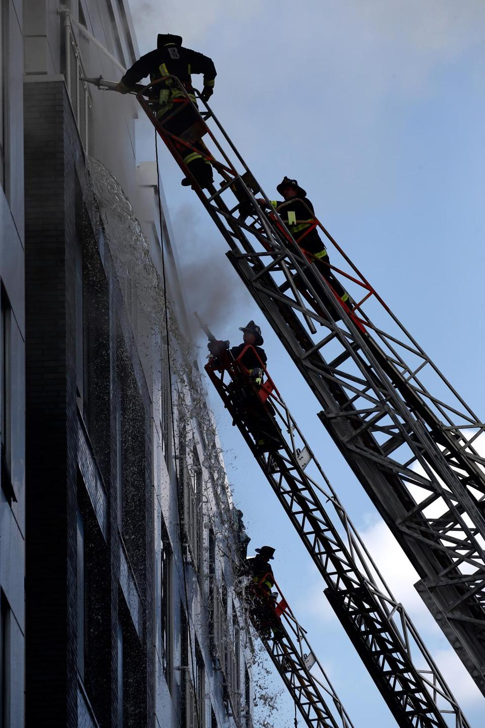 06-28-2017: Dorchster, MA: Firefighters at the scene of multiple alarm fire at 1977 Dorchester Ave. in the Dorchester neighborhood of Boston, Mass. June 28, 2017. Photo: David Ryan, Boston Globe staff