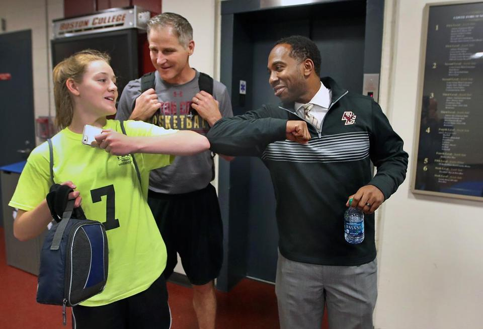 "BC athletic director Martin Jarmond, with women's basketball coach Erik Johnson and Johnson's daughter, Avery, is known for his people skills. ""I always told him he could sell ice to an eskimo,"" said his former college basketball coach, Jerry Wainwright."