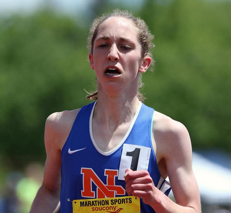 Clare Martin, breaks a school record in the 1 miler in 4:51:75 on Saturday, during the MIAA Division 1 track & field championship at Cawley Stadium. Mark Lorenz for the Boston Globe.