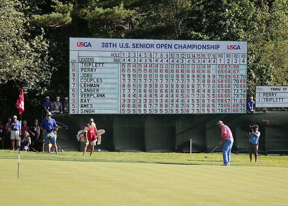 The scoreboard tells the story after Kenny Perry hits his putt on the final hole, winning the US Senior Open Championship.