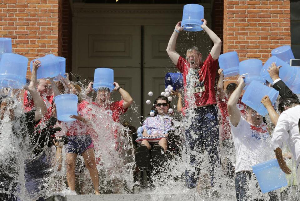 Governor Charlie Baker, right center, participated in the Ice Bucket Challenge with its inspiration, Pete Frates, center.