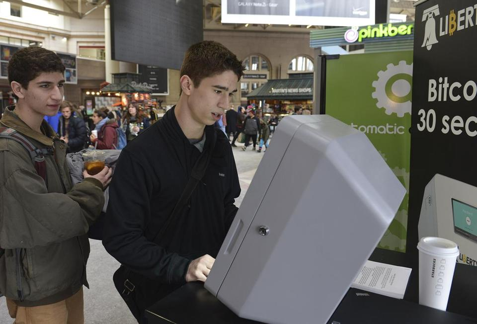 Boston, MA 021914 Friends Nick Pretti (Cq), 17 (left), and Davis Foster (Cq), both from Wellesley check out the Liberty Teller machine for Bit Coin ATM machine on its first day February 19, 2014 at South Station. (Essdras M Suarez/ Globe Staff)/BIZ