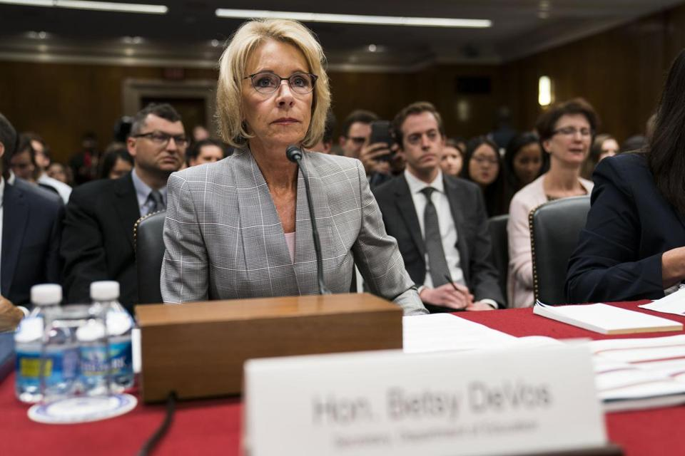 FILE-- Education Secretary Betsy DeVos testifies before a subcommittee of the House Appropriations Committee on Capitol Hill, in Washington, June 6, 2017. The Massachusetts attorney general filed a lawsuit on July 6 against the Education Department and DeVos, challenging the departmentÕs move last month to freeze new rules for erasing the federal loan debt of student borrowers who were cheated by colleges that acted fraudulently. (Doug Mills/The New York Times)