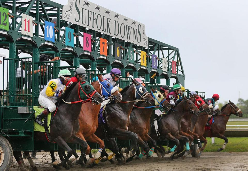 East Boston- 10/03414- It was the last day of racing at Suffolk Downs which will be ending live racing. Horses leave the gate for the last race. Boston Globe staff photo by John Tlumacki (sports)