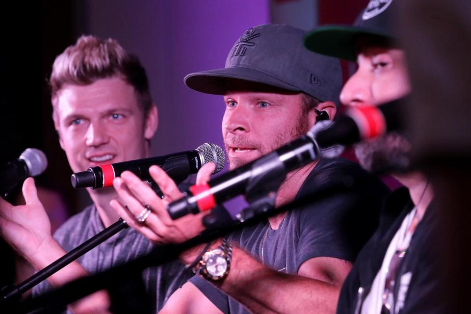 Nick Carter, Brian Littrell, and AJ McLean answered questions during a short set for Mix 104.1 listeners at the Revere Hotel on Friday.