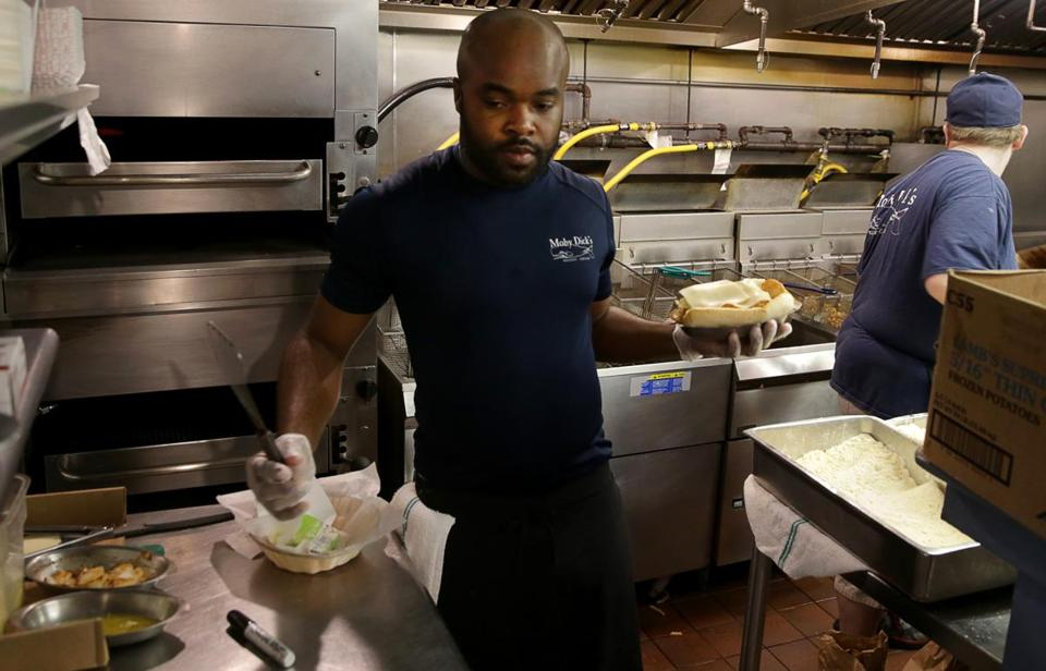 Kevon Sinclair, from Jamaica, holds an H-2B work visa. He's working for a third season at Moby Dick's.