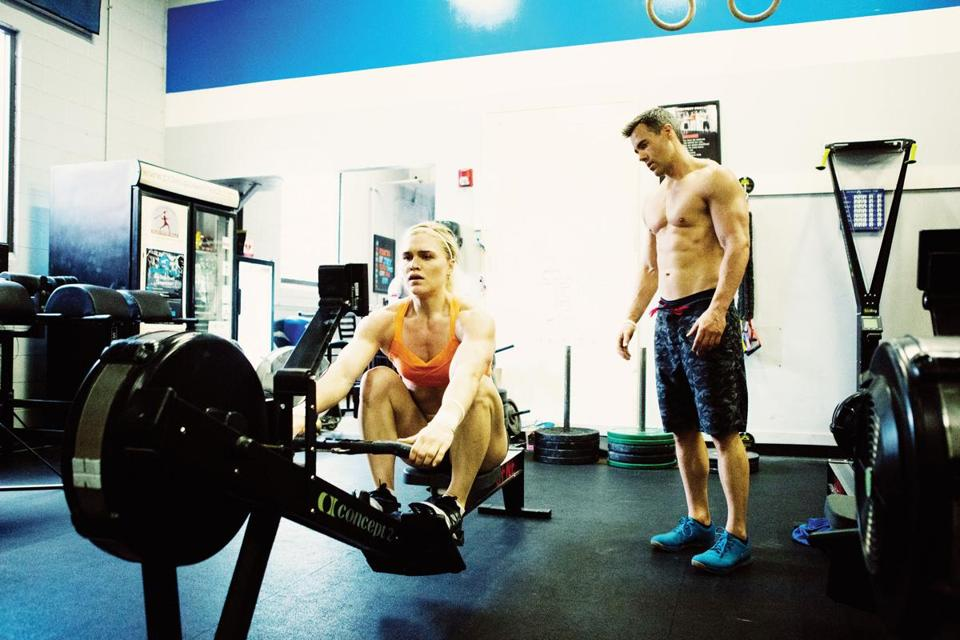 Ben Bergeron puts Katrin Davidsdottir through her paces at CrossFit New England.  She trains five or six days a week for up to eight hours each day.