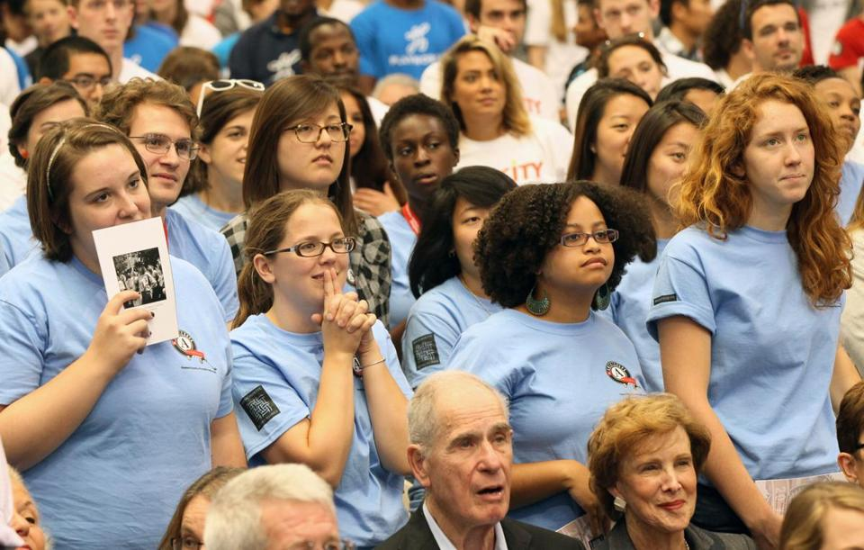 SEPTEMBER 12, 2014- -- MEDFORD -Service Volunteers stand as they wait for the feed from the White House to be sworn as this year on the 20th anniversary of AmeriCorps which, in Massachusetts amounts to a very large gathering of several thousand former AmeriCorps members at Tufts University on Friday (globe staff photo :Joanne Rathe section: metro reporter: opic:e)