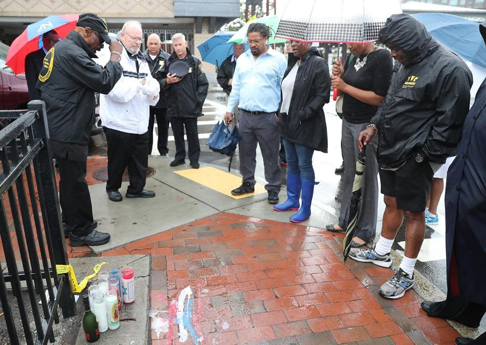 Father Jack Ahern from St. Patrick's of Roxbury led a prayer Friday at the site in Dudley Square of the stabbing death of 18-year-old Anthony Woodbridge.
