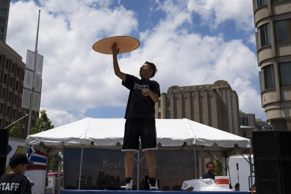 Michael Testa flipped a pizza in the air at Saturday's Boston Pizza Festival.