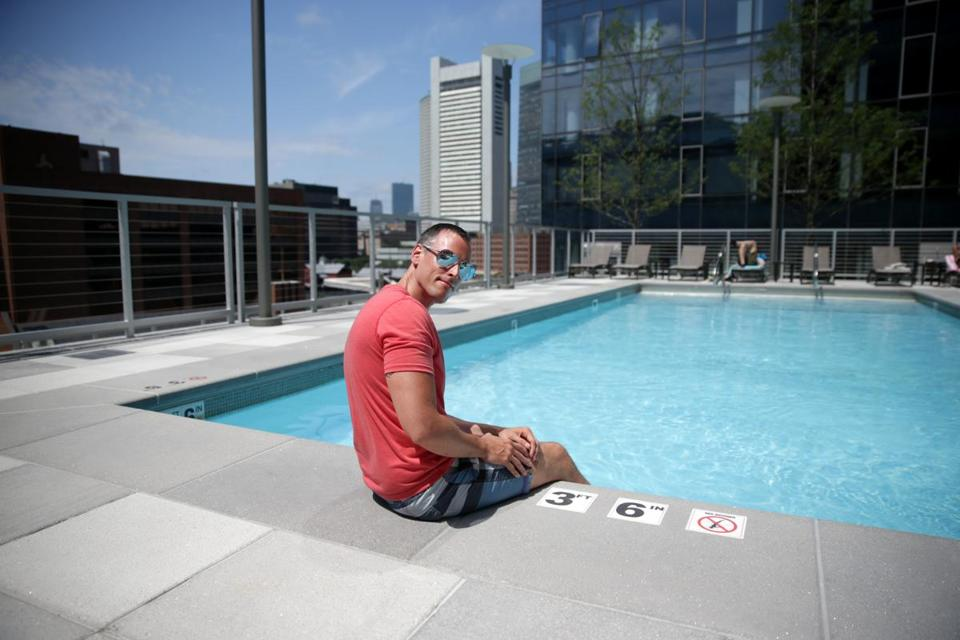 Brian Rivers sat by the swimming pool on the roof of his apartment building in the Seaport.