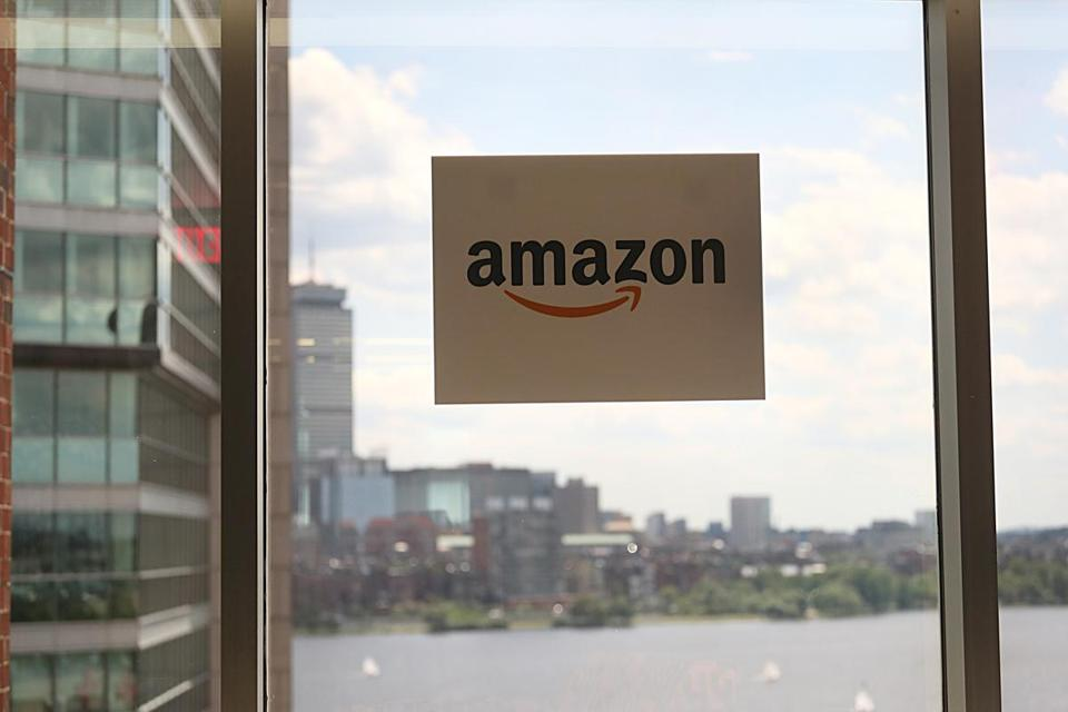 An Amazon sign in the window of the company's Cambridge offices.