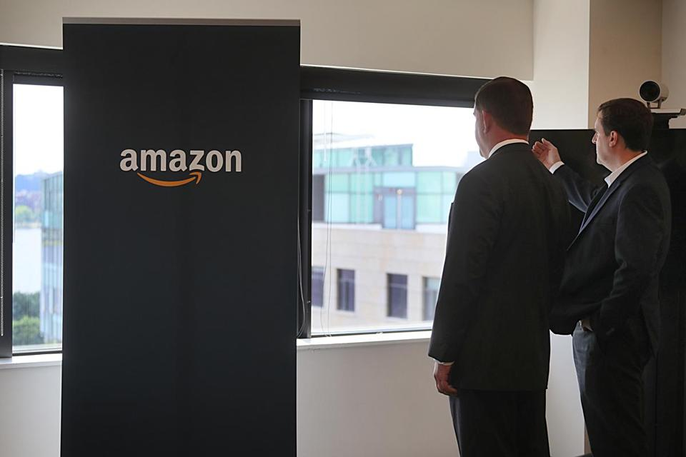 Boston Mayor Martin Walsh and State Representative Jay Livingstone looked at the view to Boston from the Amazon Cambridge offices.