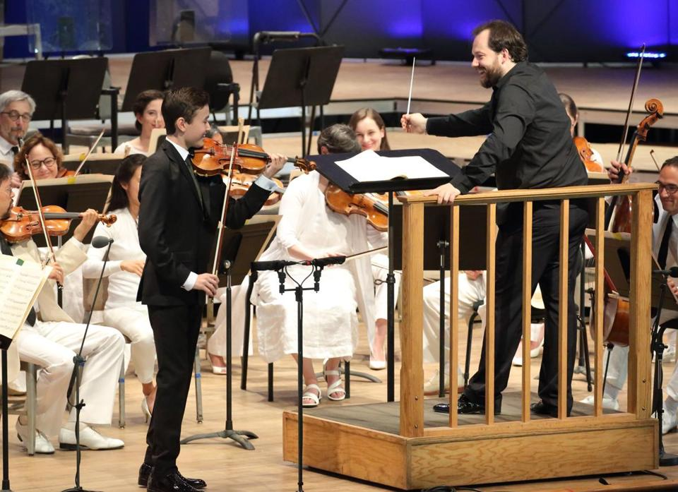 Daniel Lozakovich (left) performs with Andris Nelsons and the Boston Symphony Orchestra at Tanglewood.
