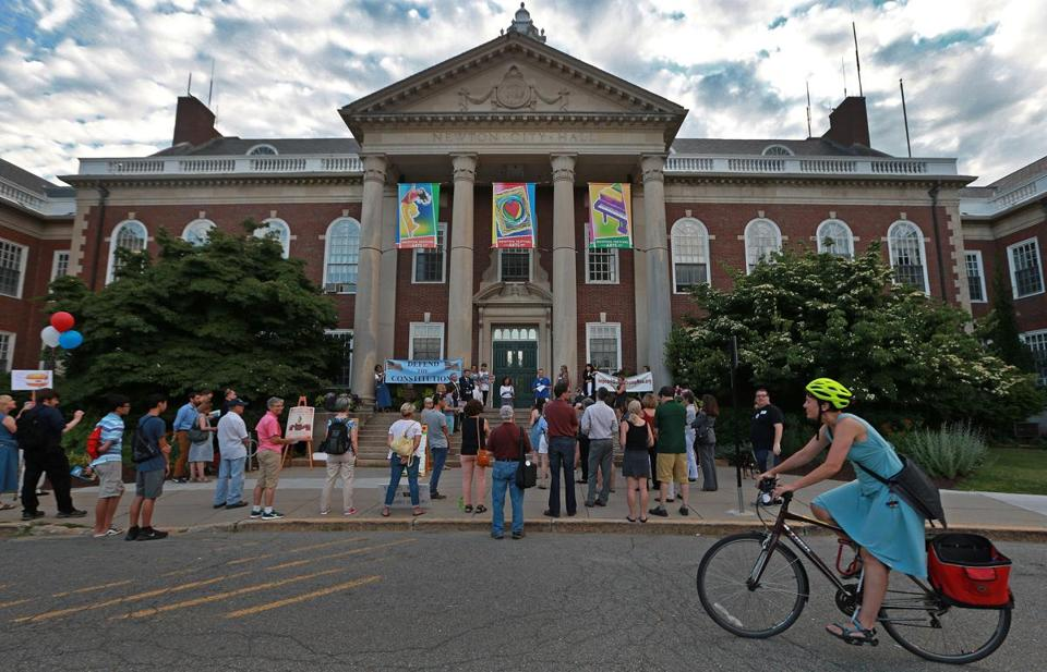 Newton MA: July 10, 2017: Newton residents staged a protest outside of City Hall prior to a City Council meeting, supporting the passing of as resolution calling for the impeachment of President Donald Trump. (Globe Staff Photo/ Jim Davis)